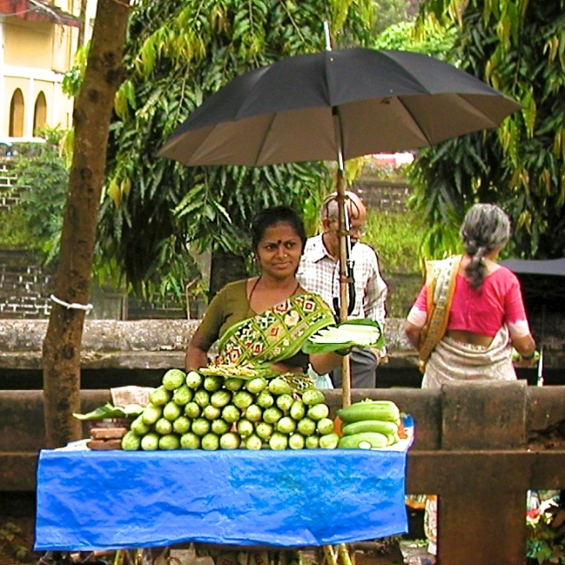 photos of a woman selling cucumbers at the Mangeshi Temple Goa by Arun Shanbhag