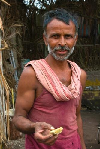 Photo of Farmer offering Jaggery or Gur by Arun Shanbhag