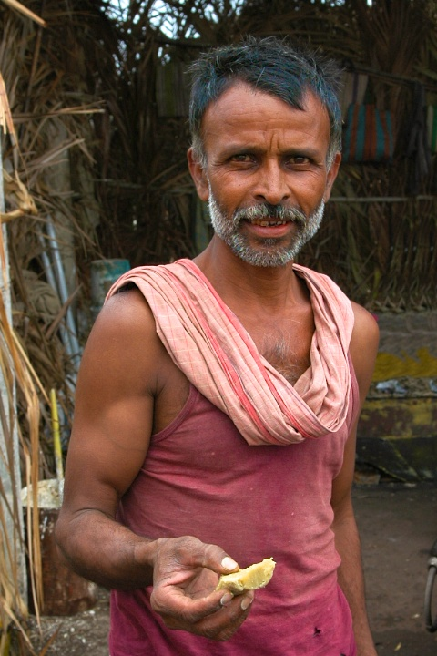 Photo of Farmer in rural india offering Jaggery or Gur by Arun Shanbhag