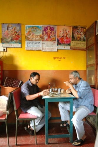 Pics of two guys drinking chai at Kamakshi Canteen Ramnathi Temple Goa Arun Shanbhag