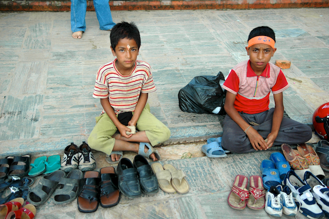 pics of boys tending chappals at Pashupatinath Temple, Kathmandu, Nepal by Arun Shanbhag