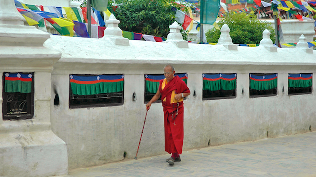 Devotees strolling around the stupa