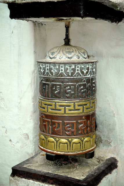 photos of a prayer wheel at Baudhanath Stupa Kathmandu Nepal by Arun Shanbhag