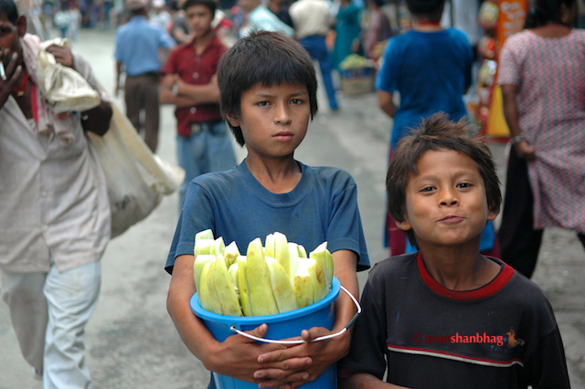 Pics of Kids selling cucumbers in a village enroute to Kodari by Arun Shanbhag