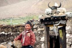 photos of boy outside a Tibetan home Kailash Manasarovar by Arun Shanbhag