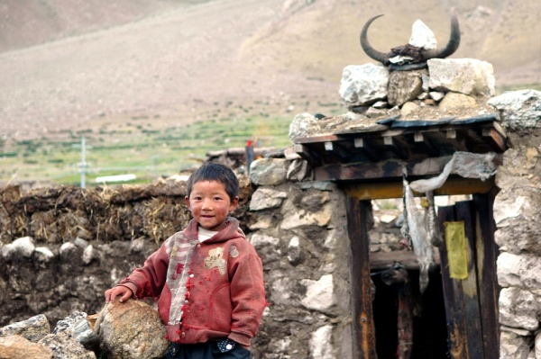 photos of boy outside a Tibetan home Kailash Manasarovar by Arun Shanbhag