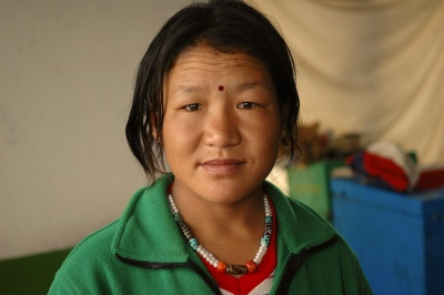 photo of Chinese mother at her home store by Arun Shanbhag
