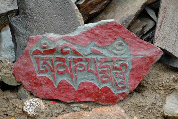 pics of stone tablets inscribed with Om Mani Padme Hum at Kailash by Arun Shanbhag