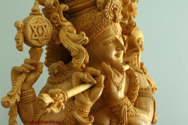 Closeup of RadhaKrishna Sculpture in white wood for Krishna Janmashtami Gokulashtami