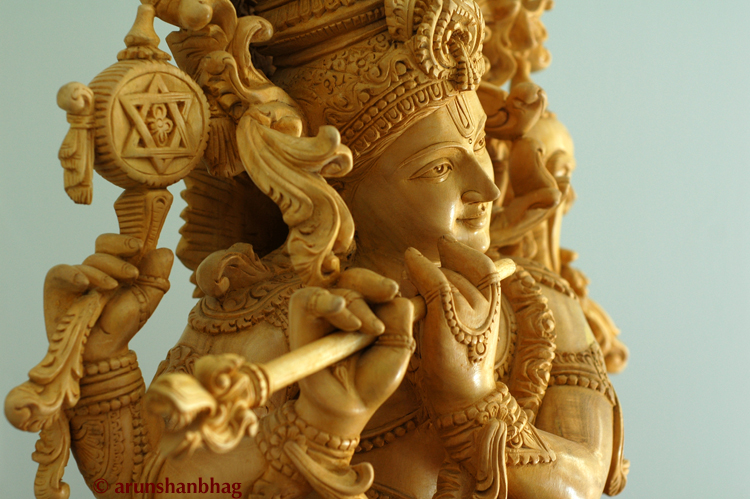 Closeup of RadhaKrishna Sculpture in white wood for Krishna Janmashtami Gokulashtami