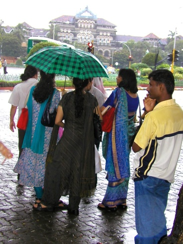 photos of people waiting at a busstop in the monsoon rains in Colaba by Arun Shanbhag
