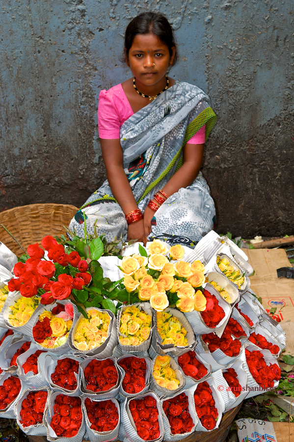 pictures of Young girls selling roses at the Dadar Flower Market, Mumbai by Arun Shanbhag