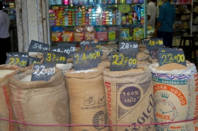 Varieties of rice and grains are sold by weight