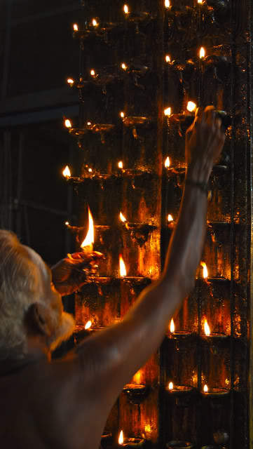 photos of Lighting Oil Lamps at the Meenakshi Temple Madurai by Arun Shanbhag