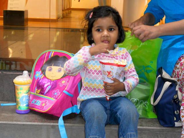 Meera with popcorn at Phoenix Mall by Arun Shanbhag