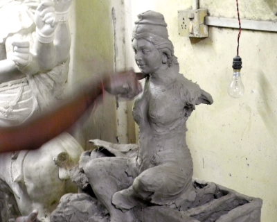 Artist crafting Durga Devi in clay Mumbai 2011 by Arun Shanbhag