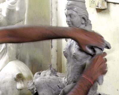Artist crafting Durga Devi in clay Mumbai 2011 by Arun Shanbhag