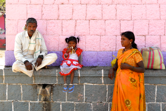 Daughter eating a banana behind the Durga Temple at a Marathi Village by Arun Shanbhag