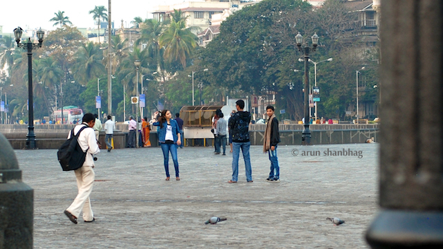 Tourists posing for pics at the Gateway of India by Arun Shanbhag