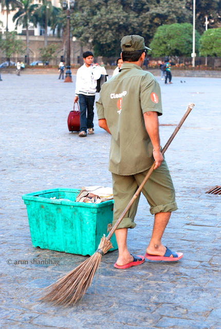 Picture of a Sweeper at the Gateway of India by Arun Shanbhag