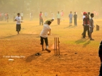 Pictures of folks playing cricket at the Oval Maidan in Mumbai by Arun Shanbhag