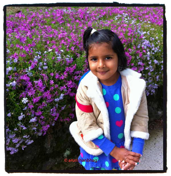 Pics of Meera posing in front of a phlox garden flowers by Arun Shanbhag