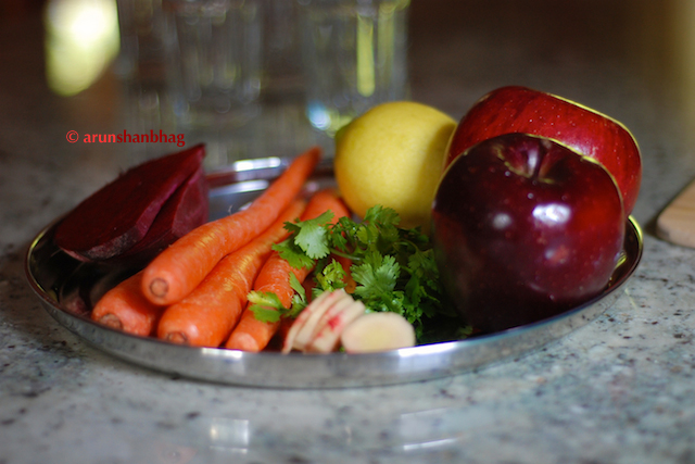 pics of vegetables carrots, beet, apples ginger and lemon in Blood Red Juice by Arun Shanbhag