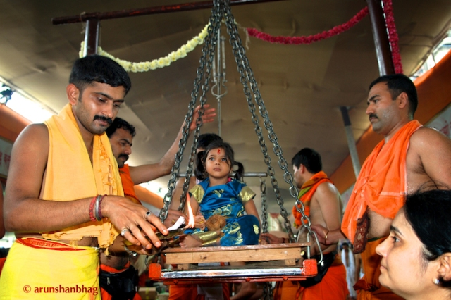 pictures of Meera on the scales at the GSB Seva Mandal  by Arun Shanbhag