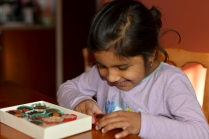 picture of Meera enjoying chocolate in Boston by Arun Shanbhag