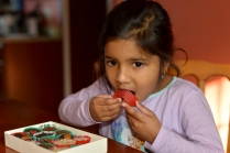 picture of Meera enjoying chocolate in Boston by Arun Shanbhag