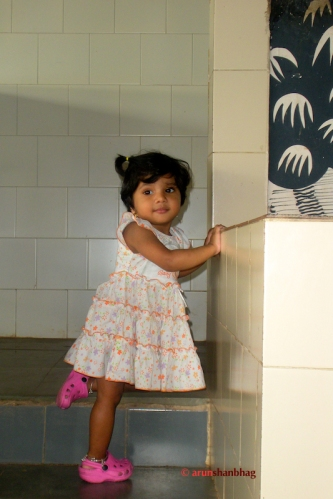 pictures of Meera sneaking up stairs at Madgaon Station by Arun Shanbhag