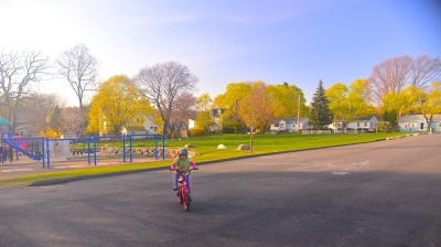 photo of Meera riding here bicycle at Stratton School by Arun Shanbhag