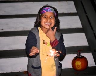 pic of Meera celebrating Diwali Deepawali with missing tooth in Boston by Arun Shanbhag