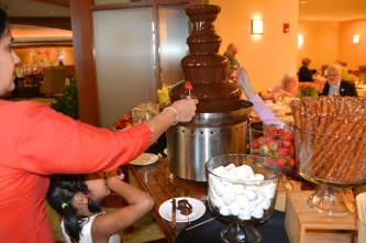 pictures of M & Meera at chocolate fountain at the Seaport Hotel Boston Thanksgiving Brunch by Arun Shanbhag