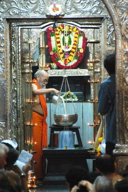Photos of Swami performing Abhishek during MahaShivaratri Festival at Ramnathi Goa by Arun Shanbhag