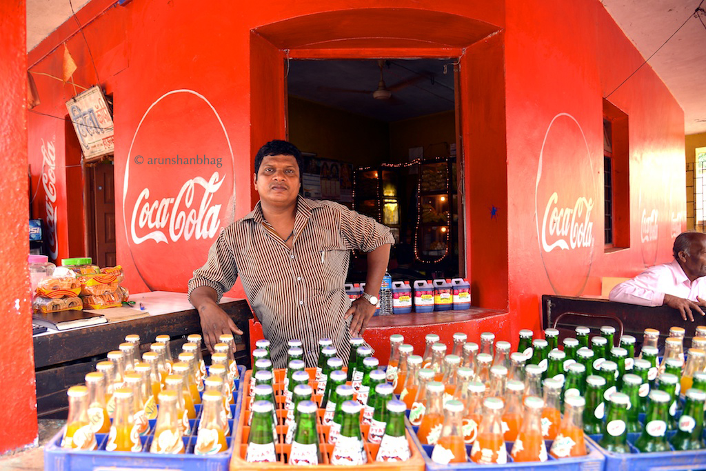 Photos of the Soda store owner at the Neeta Canteen by the Ramnathi Devasthan Goa by Arun Shanbhag