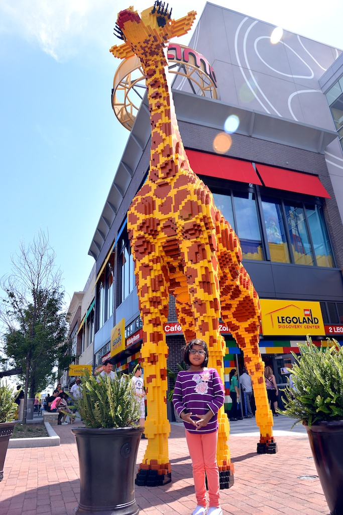 photo of giraffe in front of Legoland Boston by Arun Shanbhag