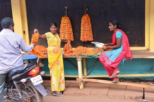 pics of lady selling marigold stringers Kumta by Arun Shanbhag